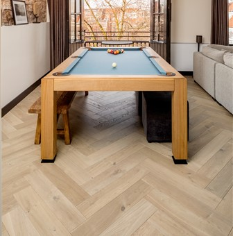 Hakwood Muse herringbone flooring in pool table room
