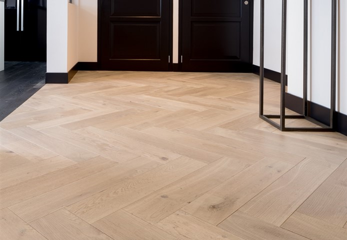 Hakwood herringbone Muse flooring at entrance hall