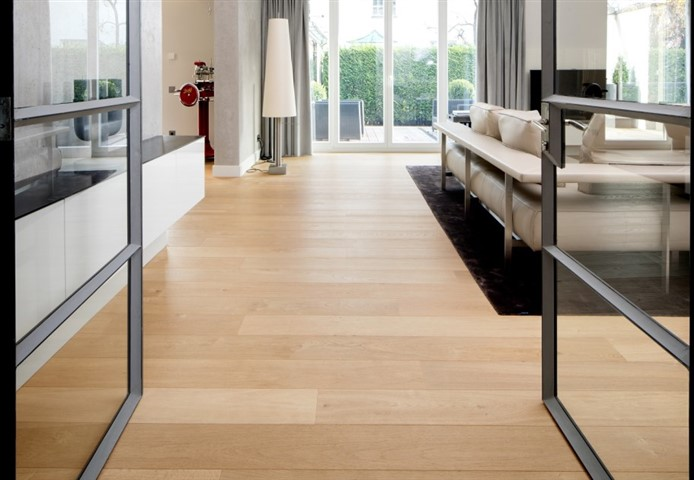 Hakwood Bespoke flooring through glass doors.