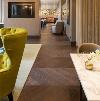 Hakwood chevron flooring in HR club Hyatt Regency