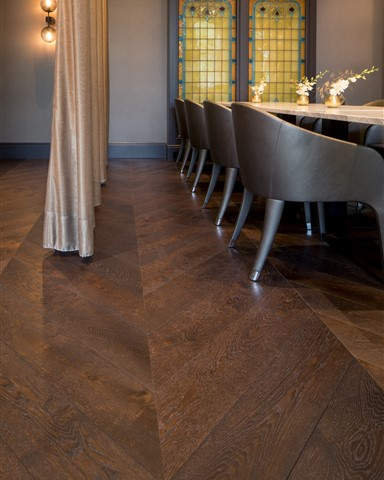 Hakwood chevron flooring with dinner table