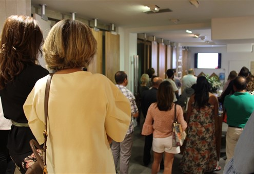 People listen to a presentation about Antique Oak flooring and our Wall Tiles.