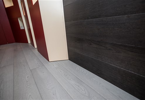 Hakwood flooring on the wall and floor.