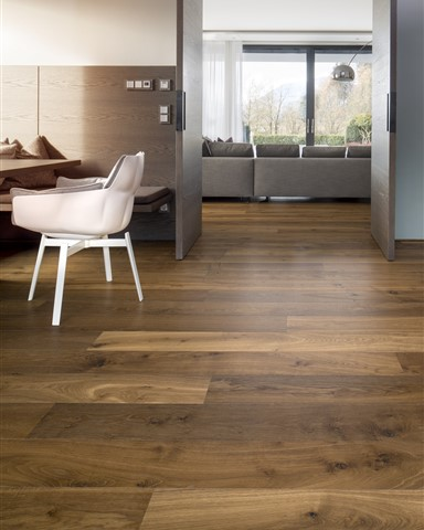 Hakwood Promise flooring in dining room with open doors to the living room