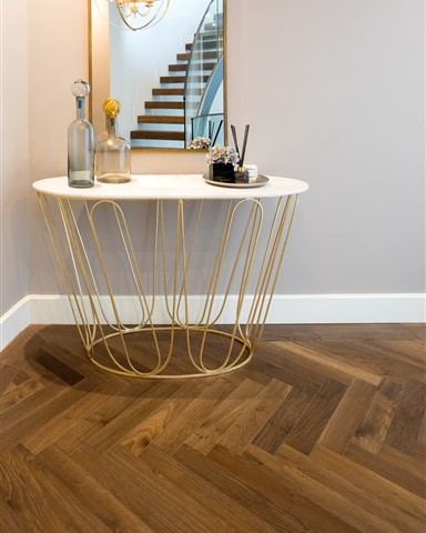 Side table in the corner of the hallway with Hakwood Promise flooring