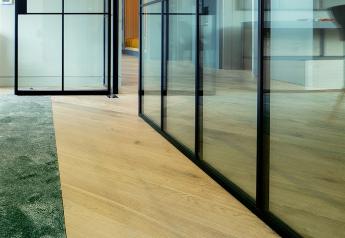 Hakwood Forza flooring in meeting room with a wall of glass