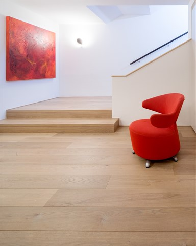 Hakwood Flourish flooring in hallway with red chair
