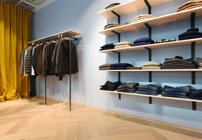 Hakwood Valor flooring in the showroom with clothing rack