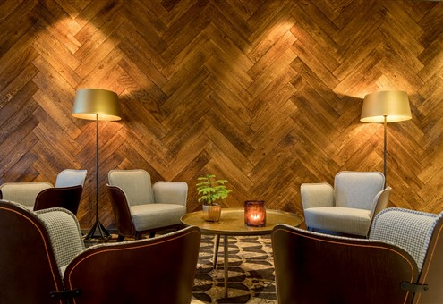 Hakwood Larroque flooring on the wall with seating furniture