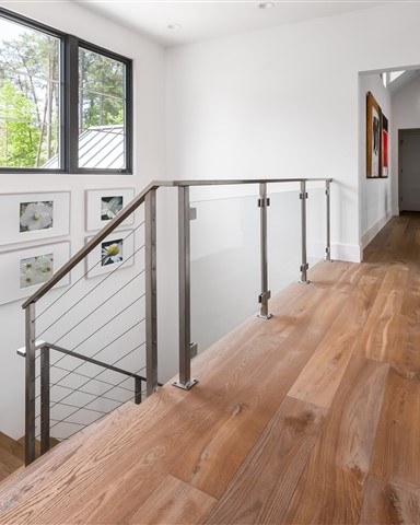 Landing with staircase contains Hakwood Bespoke flooring