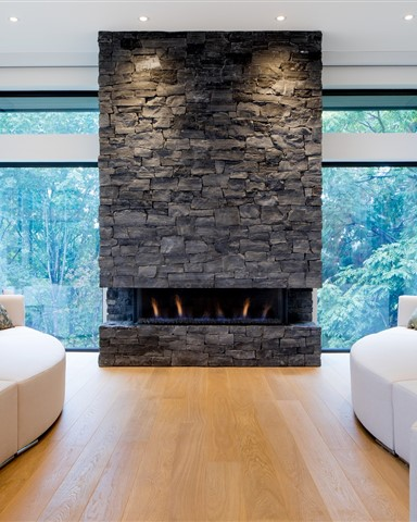 Hakwood Aura flooring in living room with beautiful stone fireplace