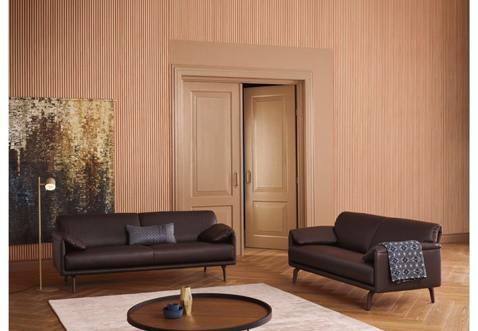 Hakwood Dawn flooring with two black benches and pink wall