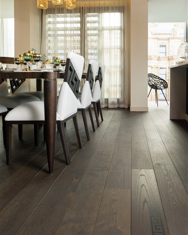 Dining room contains Hakwood Bespoke flooring