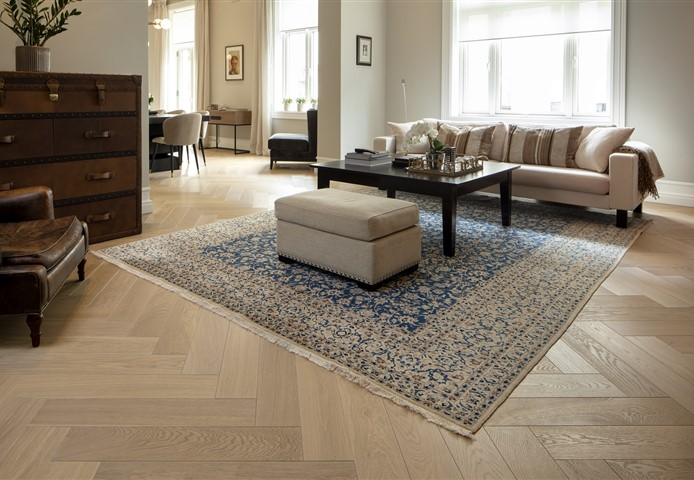 Living room contains Hakwood Valor flooring with beautiful rug