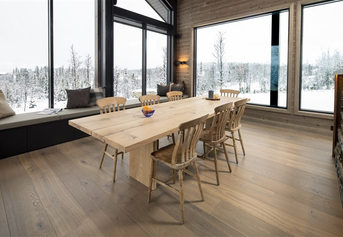 Dining room with Hakwood Heritage flooring and beautiful view