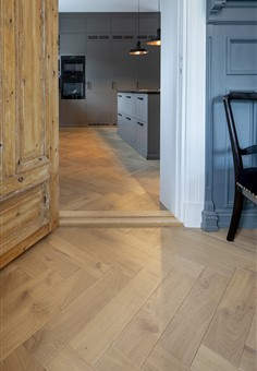 Hakwood Valor flooring in the doorways with view through the kitchen