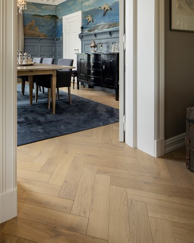 Hakwood Valor flooring in the doorways with view through the dining room