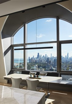 Hakwood Aura flooring by the dining table with a beautiful view at the skyline of Chicago