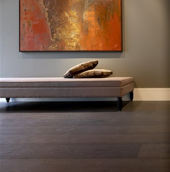 Hakwood Bespoke flooring with sofa and artwork on the wall