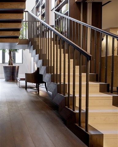 Hakwood Bespoke flooring in hallway with staircase
