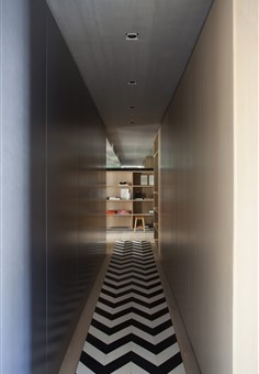 Hakwood Pure flooring in hallway with black and white rug