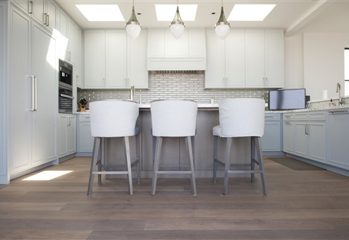 Hakwood Heritage flooring in kitchen with bar stools - photo credits Paper and Pate Photography
