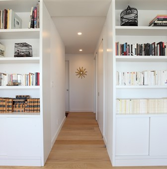 Hakwood Aura flooring in hallway with bookcases