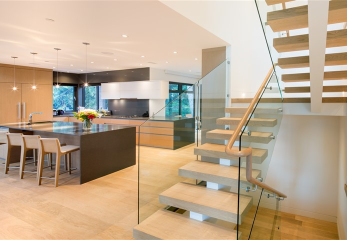 Kitchen with Hakwood Aura flooring and staircase in the corner