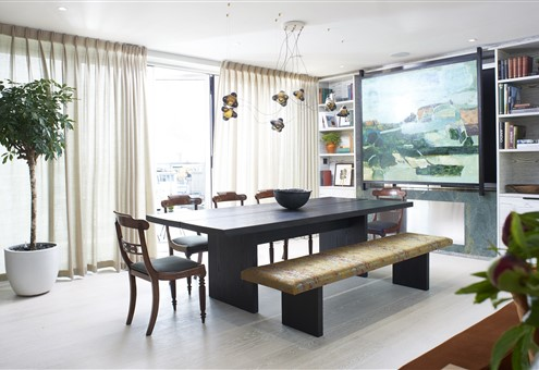 Dining room with Hakwood Vue flooring and beautiful piece of art on the wall