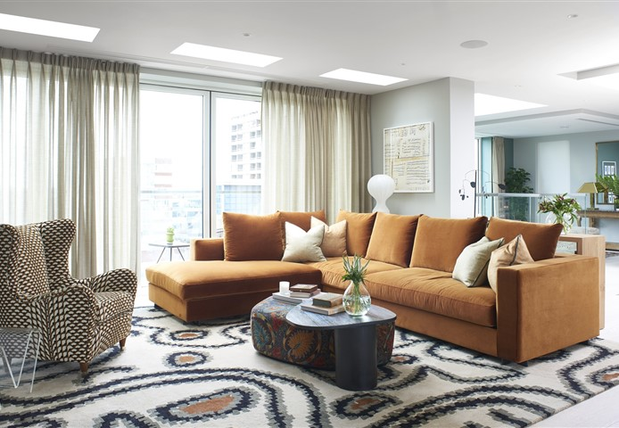 Hakwood Vue flooring in the living room with modern rug and large sofa