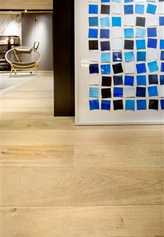 Detail of Hakwood Original flooring with beautiful blue/black/white pattern on the wall