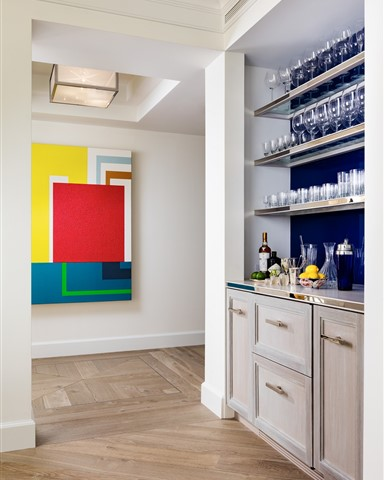 Hakwood Locke flooring in the kitchen with colorful artwork on the wall