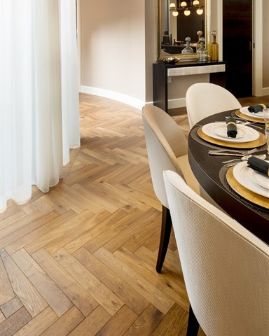 Hakwood Promise flooring in the dining room with detail of the dining table