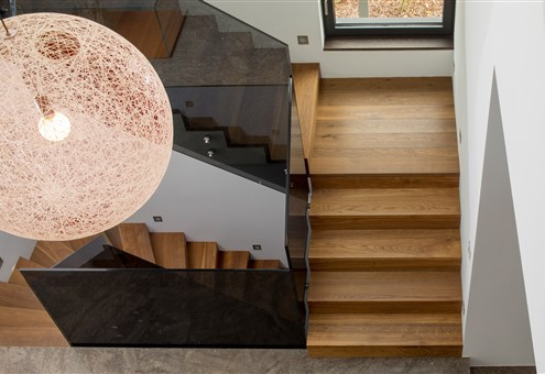 Topview of staircase with Hakwood Promise flooring and beautiful design lamp