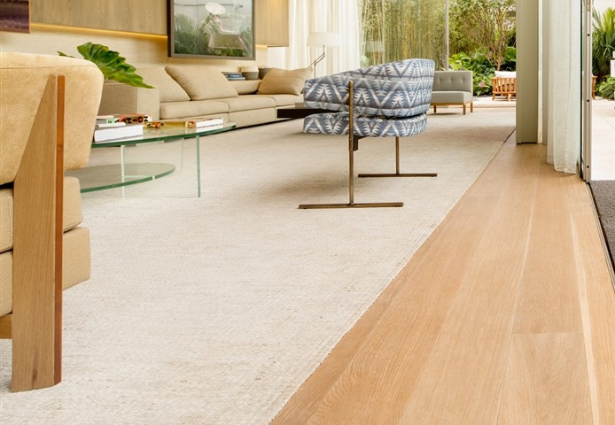 Hakwood serenity flooring in seating area and carpet.