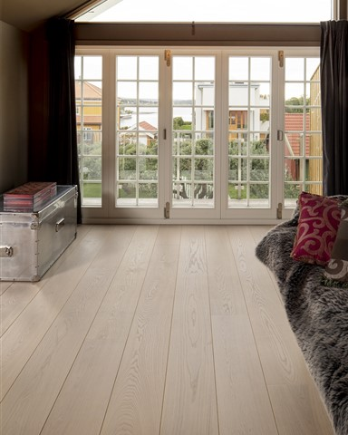 Hakwood Worthy flooring in living room with french doors