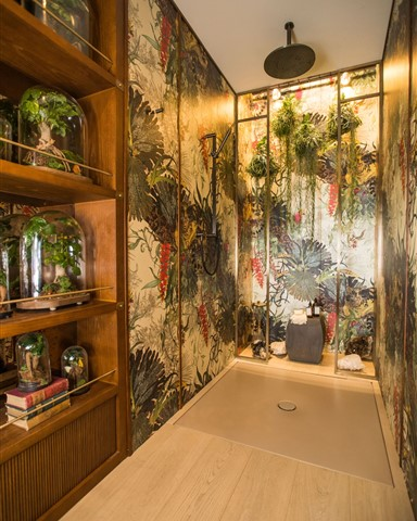 Hakwood Misty flooring in the shower with colorful jungle print wallpaper