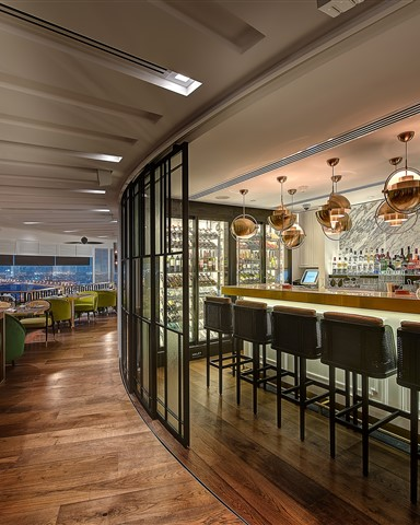 Hakwood Unfinished flooring at the bar with glass sliding doors