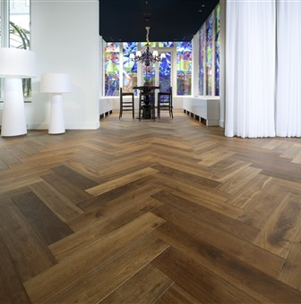 Hakwood Genuine flooring, herringbone patern with windows with stained glass.