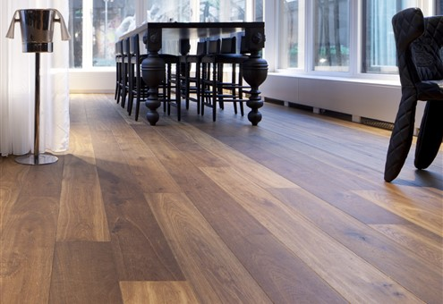 Hakwood Genuine flooring with seating area and wine cooler in the background