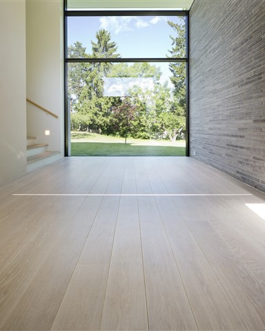 Hakwood Unfinished flooring in hallway with view