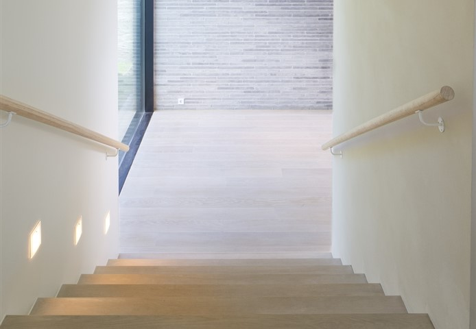 Hakwood Unfinished flooring at staircase